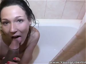 warm dark-haired in the tub bathtub mischievous for a trunk inside