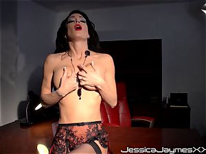 horny brown-haired Jessica Jaymes fingers her tasty coochie pie in her office