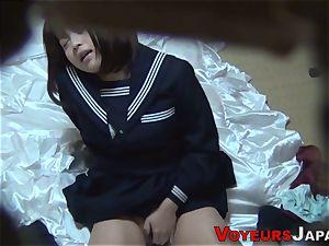 Uniformed asian babe caresses