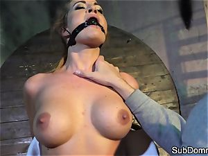 gagged stunner climaxes during restrain bondage