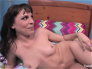 Behind the vignettes with black-haired beauty Dana DeArmond