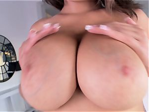 meaty chested Cassidy Banks flashes her ginormous funbags as she jacks