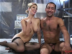 sexy platinum-blonde domme pegging her slave