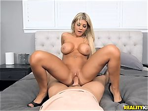 buxomy Kayla Kayden getting showered with a full flow