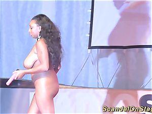 dark-hued stunner displays her huge breasts in public