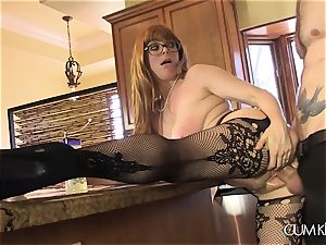 Penny Pax pounds in the kitchen