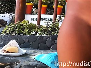 Spying on a super-cute sweetie at the naturist beach spycam web cam