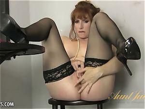 Amber Dawn joys herself wearing thigh highs.