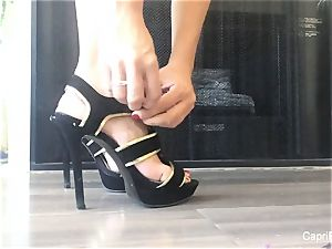 Capri flashes off her luxurious soles & attempts on some heels