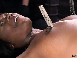 massive ebony donk flogged in device restrain bondage
