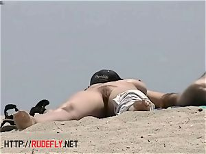 big-titted bare beach honies filmed by a spycam